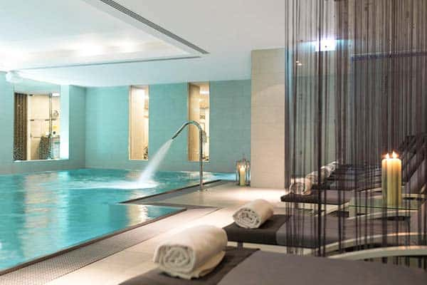 Take a dip at the hotel pool at The Ritz-Carlton, Vienna