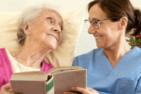 patient and nurse reading