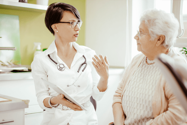 nurse explaining something to patient