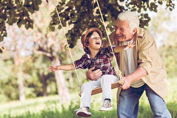 grandson and grandpa swinging