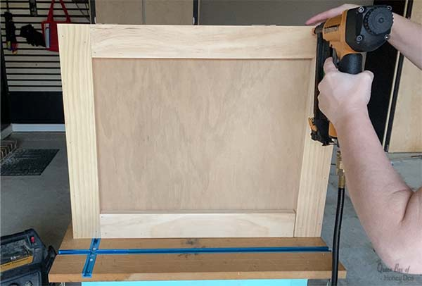 adding trim to Christmas tree shipping crate stand