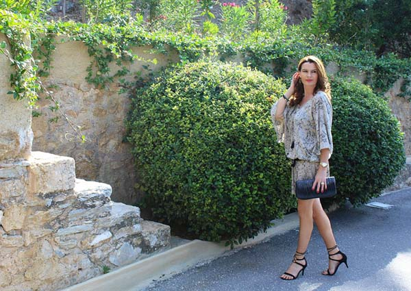Ornella is beautifully polished in a flowy mini dress and scrappy heels   40plusstyle.com