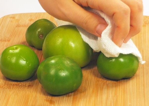 Wiping Tomatillos with Cloth