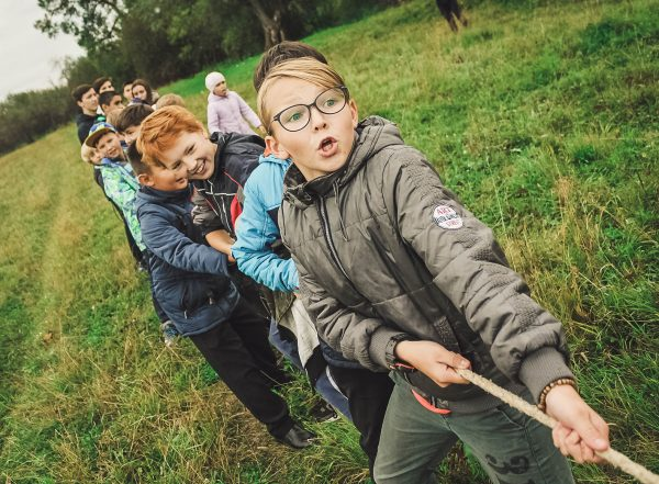 children playing tug of war text proprioceptive system