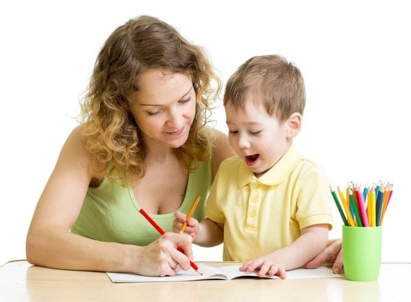 teacher helping student write and supporting pencil grasp