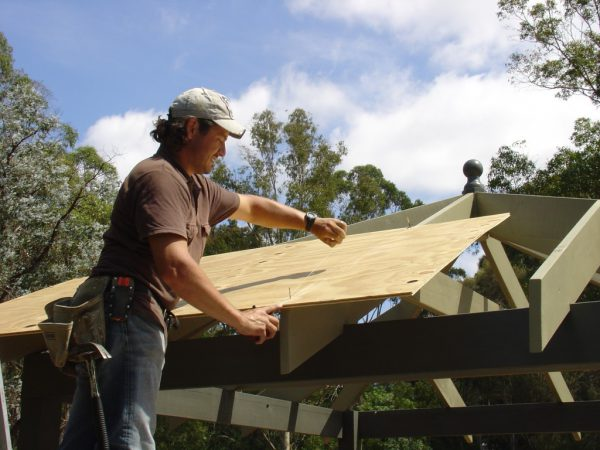 Snapping a Chalk line for cutting up the centre rafter of the outdoor gazebo