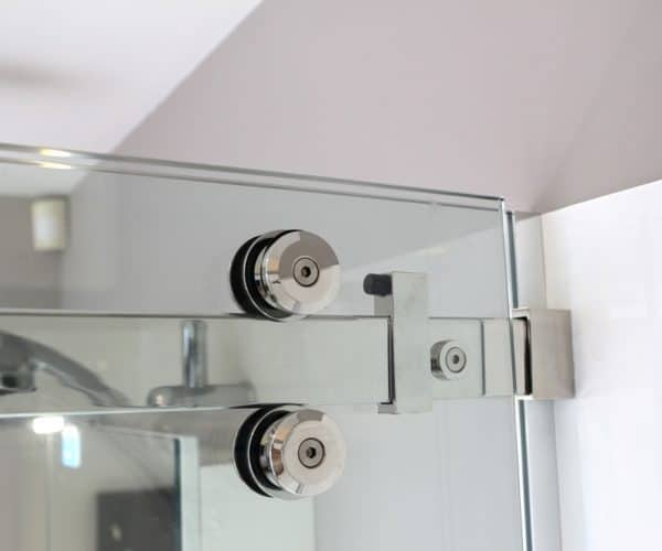 Urban shower door rail wheels closeup - Henry Brooks