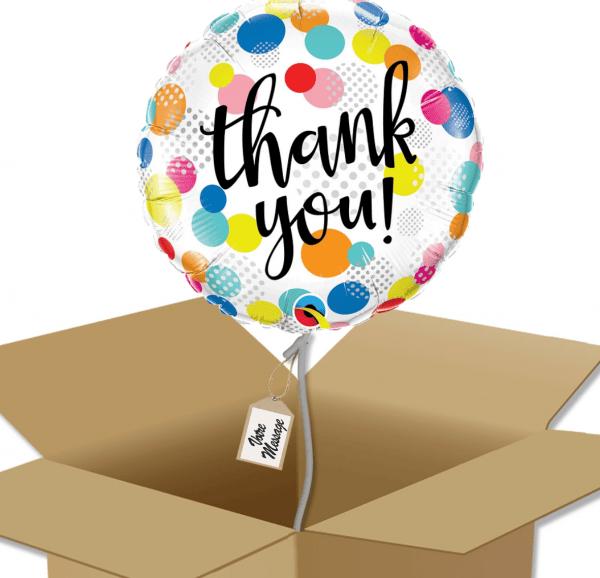 "Ballon rond écriture ""Thank You"" multicolore dans sa boîte."