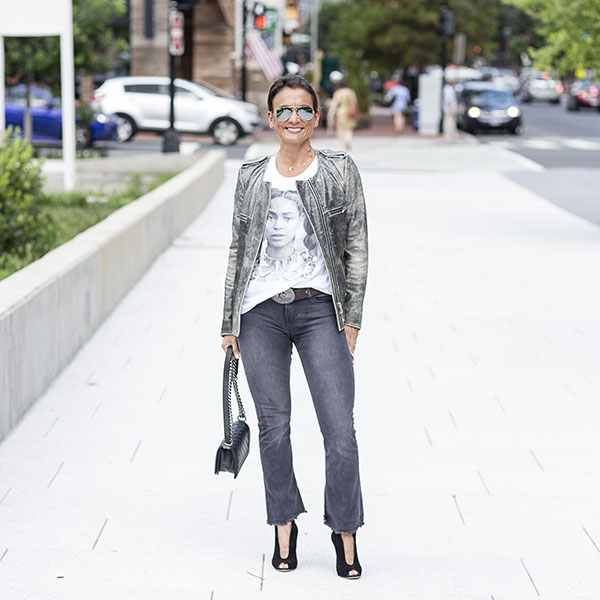 Casual style idea for women over 40: White top, leather jacket, and jeans | 40plusstyle.com