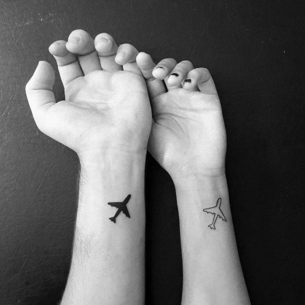 corresponding-tattoos-for-couples-airplanes-on-wrist