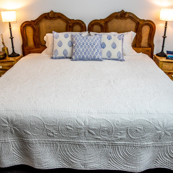 Quilt - white with quilted floral pattern