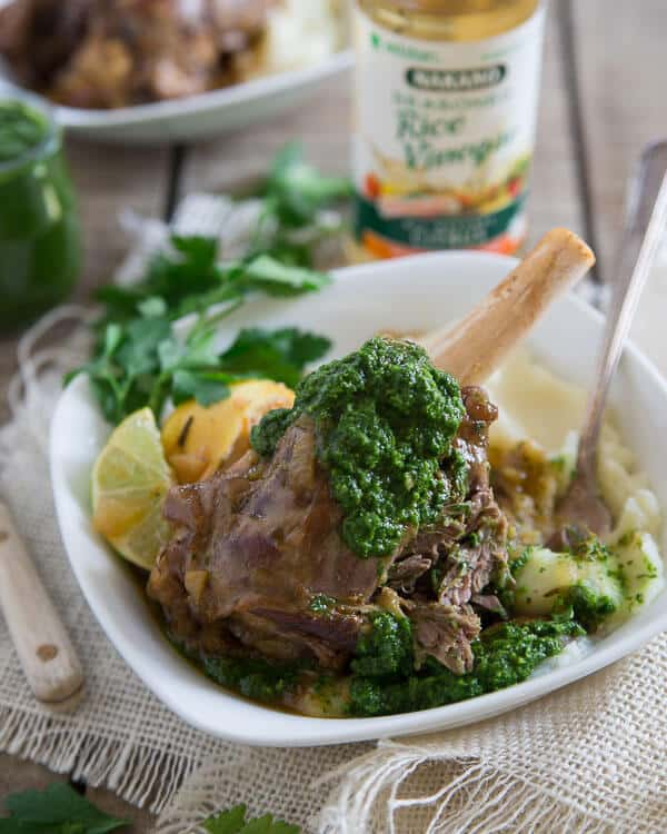 These citrus braised lamb shanks are served with a spicy green harissa. They're cooked until falling off the bone tender.