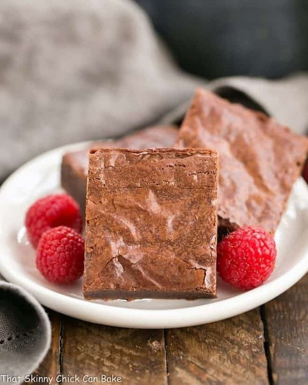 The best fudgy brownies on a white dessert plate