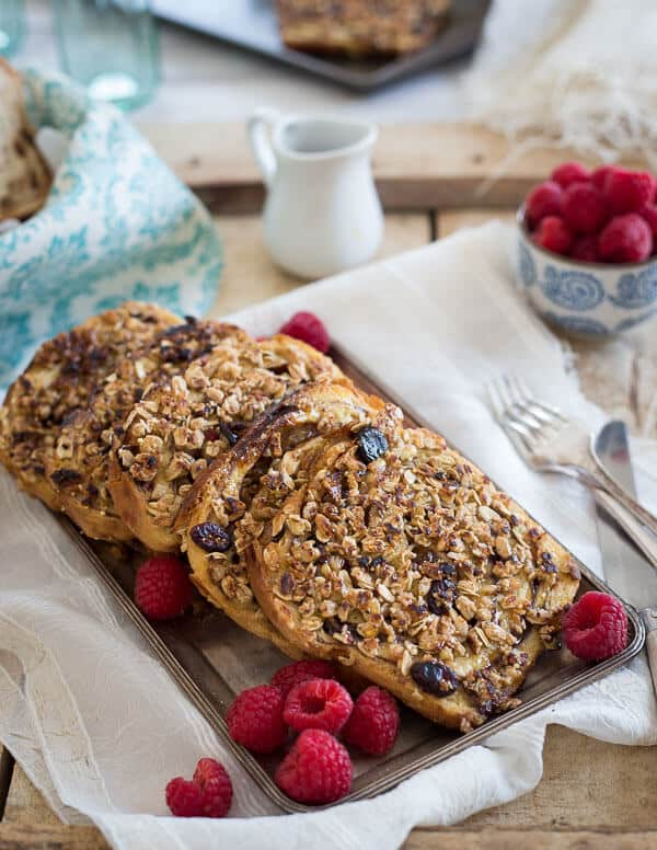 This granola French toast is made with KIND raspberry clusters with chia seeds and topped with a simple raspberry mash. It's a healthy way to jazz up French toast!