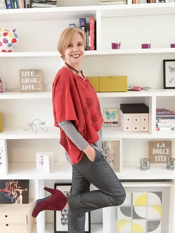 Red cropped top over grey pants - how to do more with less | 40plusstyle.com