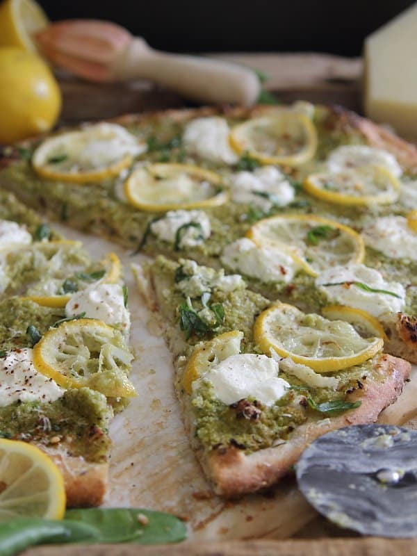 This pea and lemon pesto pizza is dolloped with ricotta for a light pizza to celebrate spring.