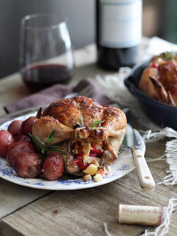 Cranberry apple rosemary stuffed cornish hens is a winter inspired alternative to roasted chicken, try it for your special weekend meal!