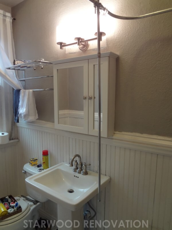 All white sink and beadboard bathroom in the Highlands in Denver