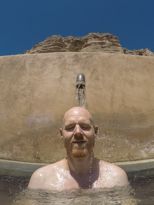 Buddy letting the warm water at the iron pool run over his head