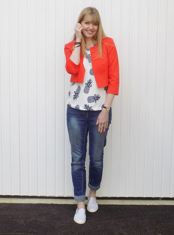 Pineapple Top with Bright Orange Jacket and Silver Pull-on Trainers | 40plusstyle.com