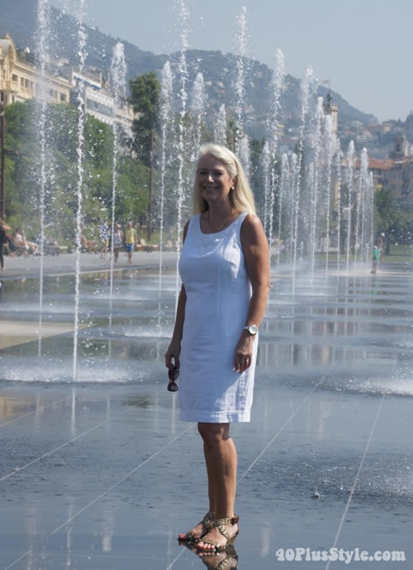 In front of waterfall in Nice wearing a white Marcs & Spencer dress | 40plusstyle.com