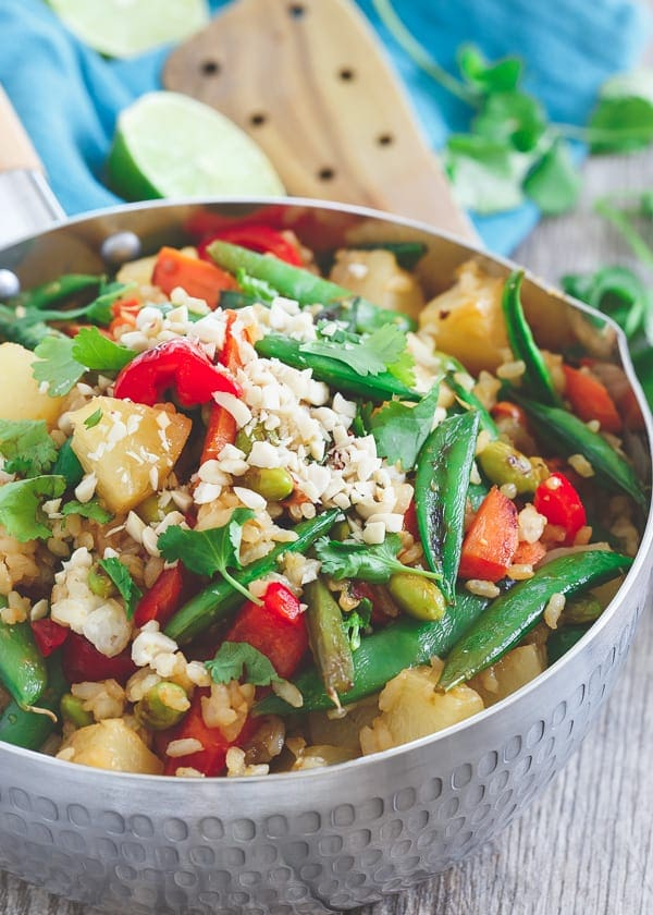 This Thai pineapple fried rice is loaded with Thai flavors, sweet pineapple and lots of Asian style vegetables for a healthy flavorful side dish or meatless meal.