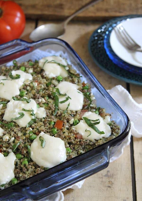 This beef pesto quinoa bake is filled with ground beef, tomatoes, peas and ricotta for an easy throw together dinner.