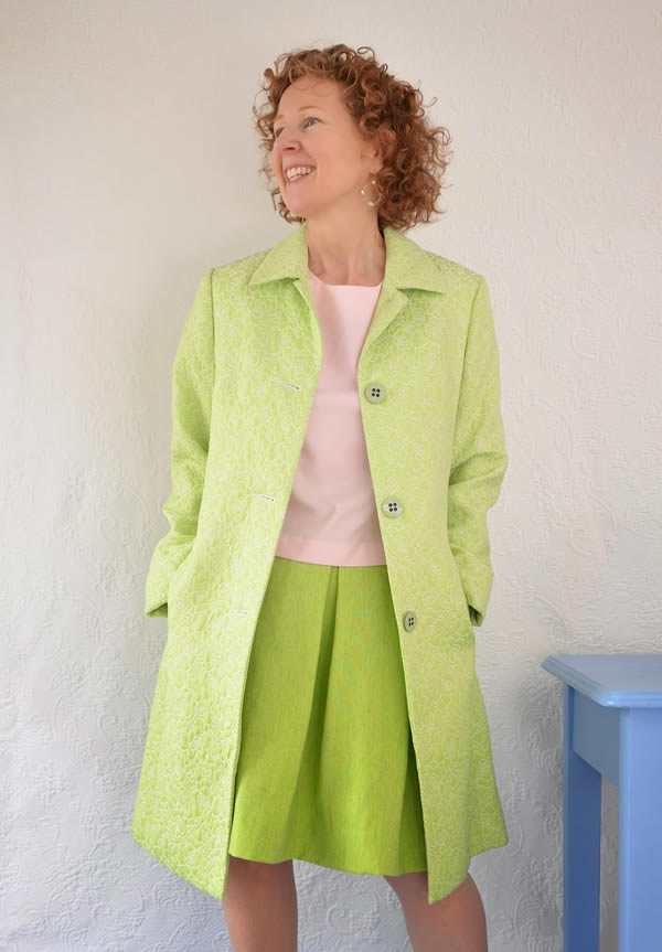 Sue wearing pink with lime green | 40plusstyle.com