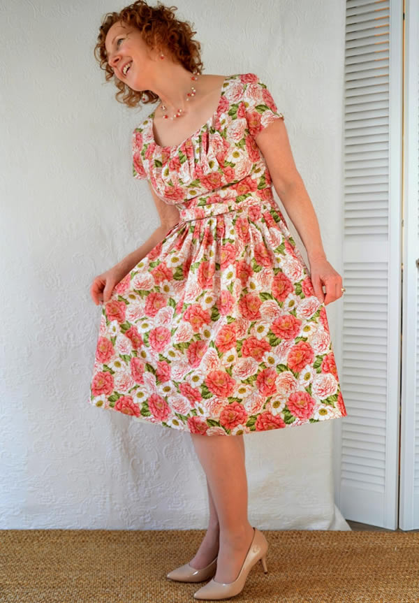 Sue wearing a colorful flower dress | 40plusstyle.com