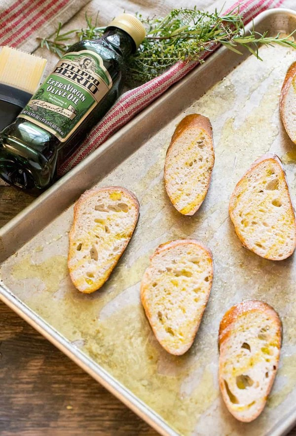 Toasting baguette slices in the oven for goat cheese mushroom toasts