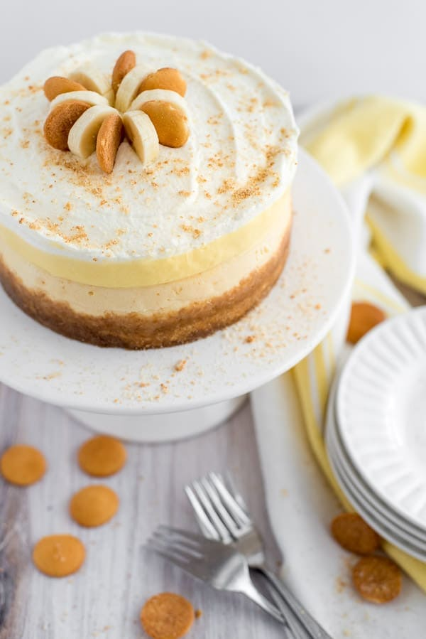 Banana cream pie cheesecake on a white plate with cookies