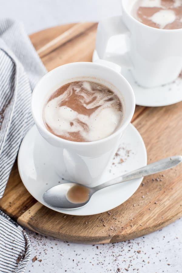crio bru in a white cup with cream