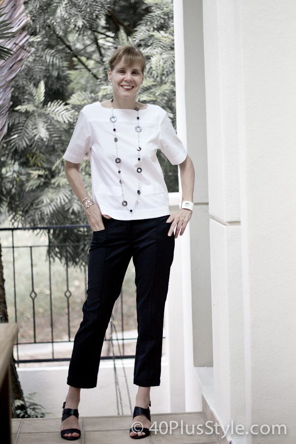 Black pants with white top and a statement necklace - a classic combination | 40plusstyle.com