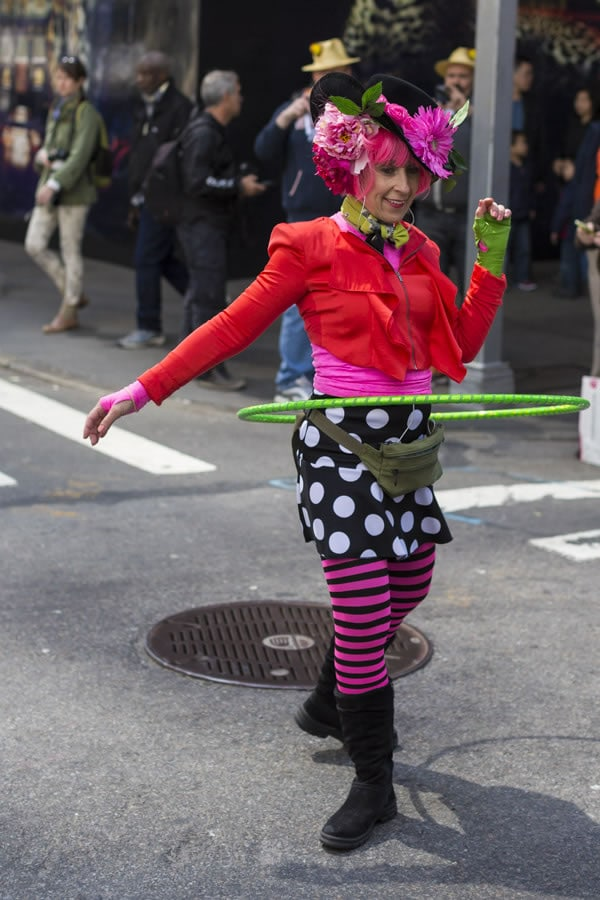 Doing the hoola hoop in colorful attire | 40plusstyle.com