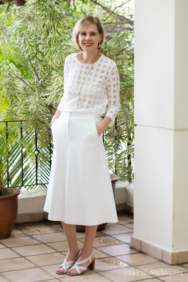 Zara cream midi skirt with Cos blouse and J S Noor golden earrings | 40plusstyle.com
