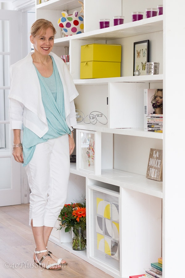 wearing white with a sea green asymmetrical top | 40plusstyle.com