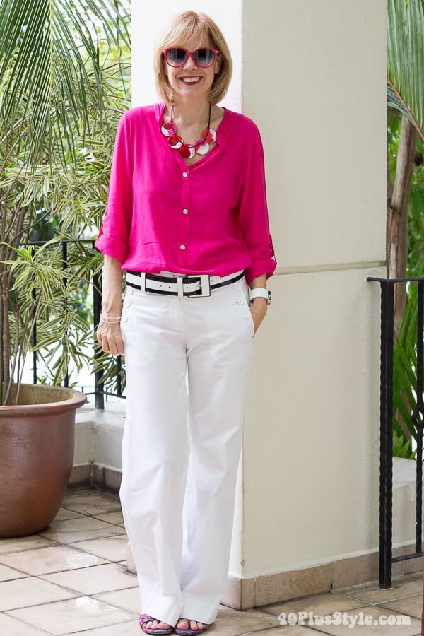 wearing bellbuttoned white pants with fuchsia top | 40plusstyle.com