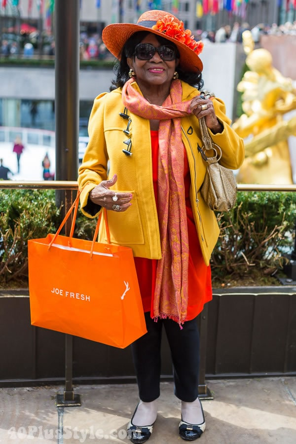 Bright yellow jacket with orange scarf | 40plusstyle.com