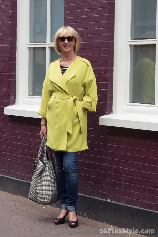 Travel diary outfits: Greetje's chic green coat and denim skinnies | 40plusstyle.com