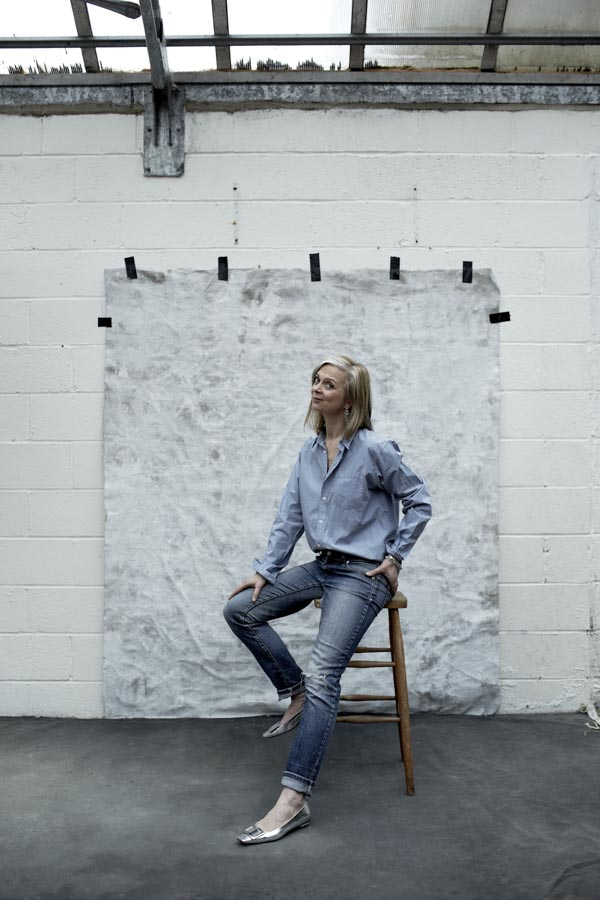 Androgynous fashion inspiration: A loose button down blouse with jeans and silver flats | 40plusstyle.com