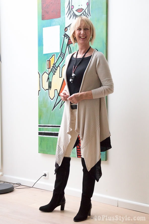 Long asymmetrical vest worn over skinnies and over the knee boots | 40plusstyle.com