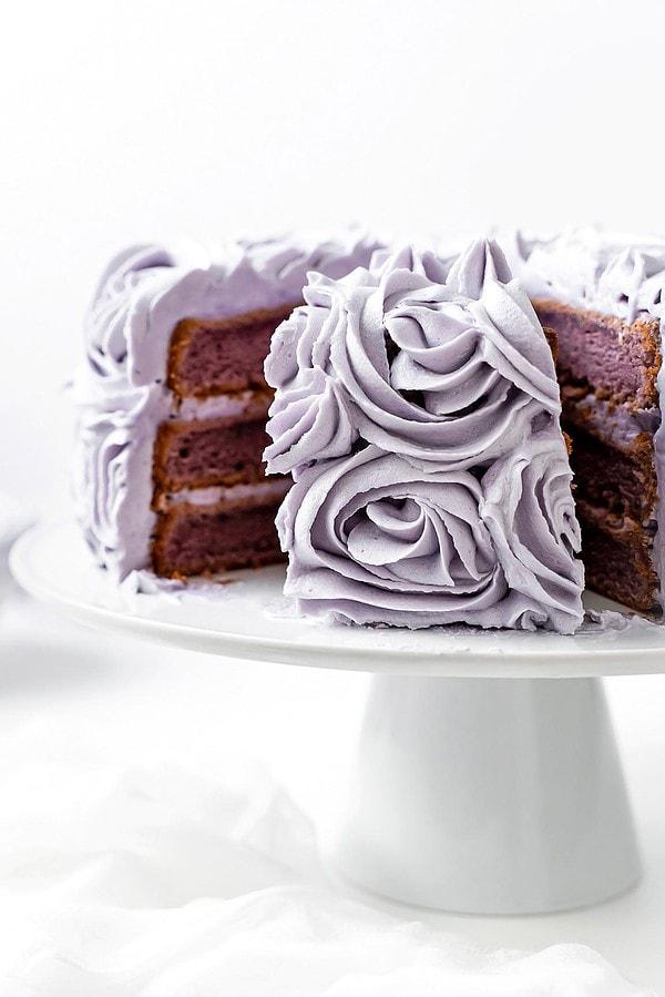 Filipino ube sponge cake piece on cake stand