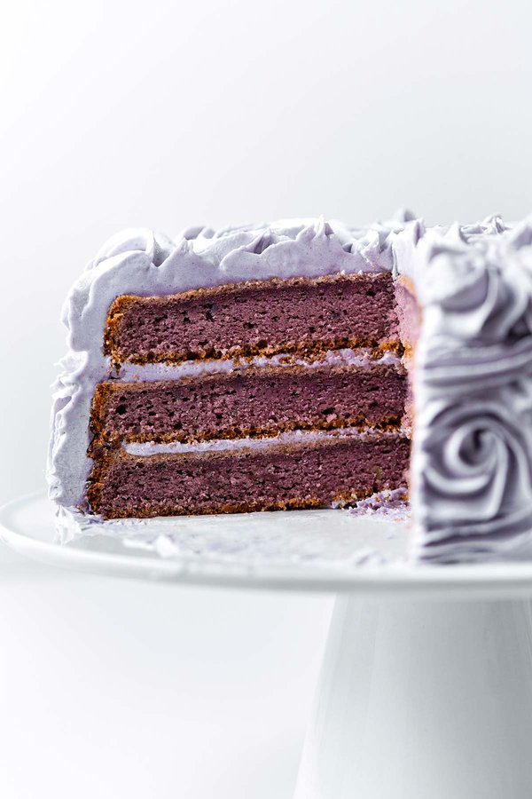 Cross section of 3-layered purple ube cake with ube halaya butter cream frosting in between