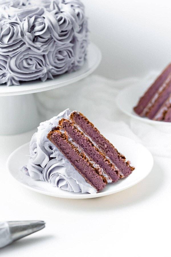 Piece of ube chiffon cake laying on its side on small plate