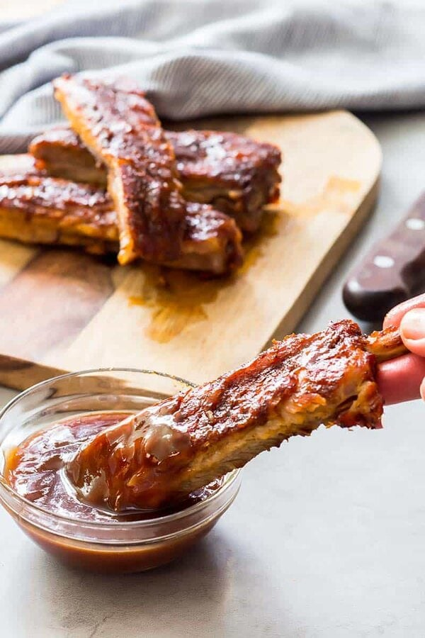 Dipping Ribs in Barbecue Sauce