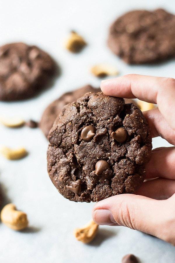 Hand holding flourless chocolate cookie