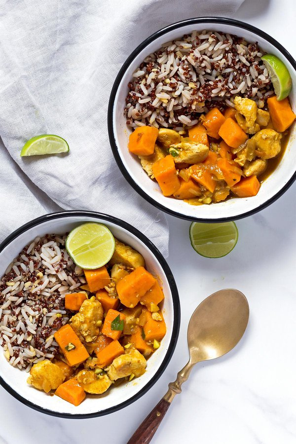 Two bowls of sweet potato curry and rice