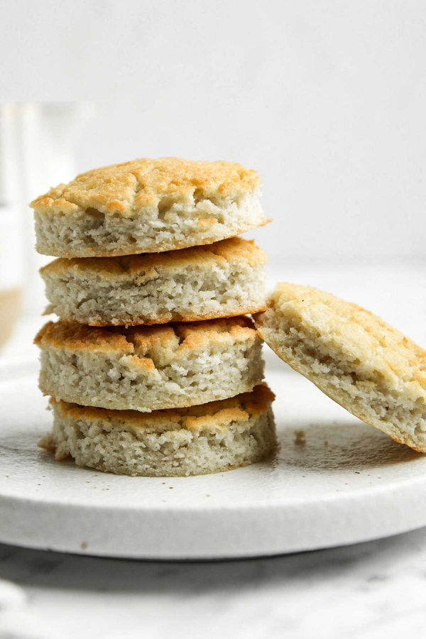Coconut Flour Biscuits stacked on small white plate