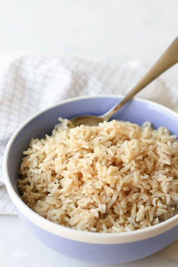 Pressure cooker brown rice in a light blue bowl