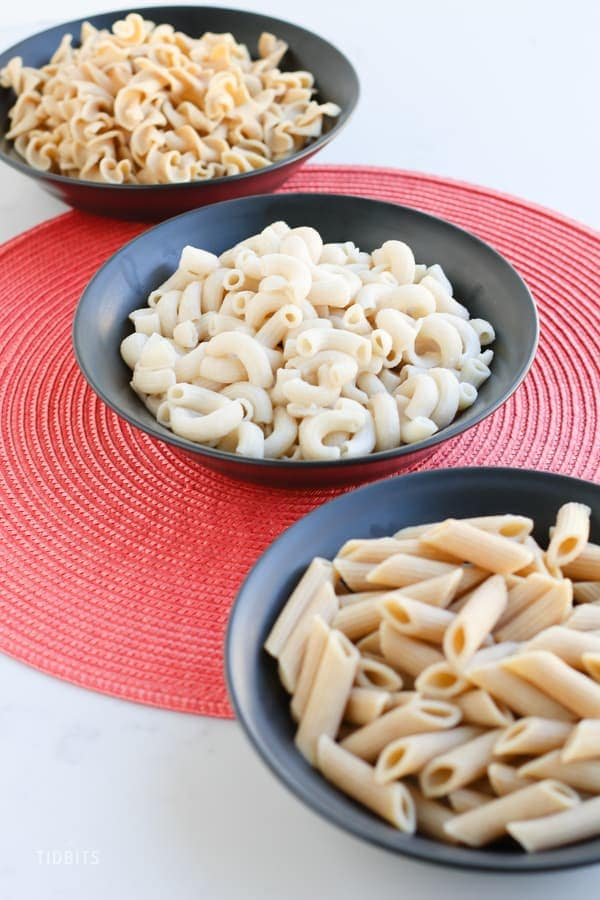 Bowls of instant pot pasta on a work surface - TIDBITS Marci